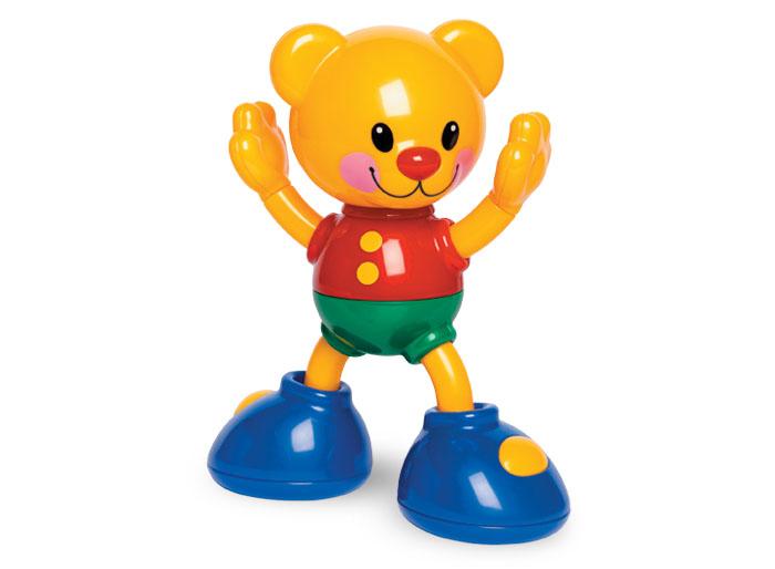 Tolo Classic Фигурка Медвежонок86421Мишка акробат Tolo toys – это занимательная игрушка для малышей от 3 месяцев. Оранжевый медвежонок с добродушной улыбкой крепко стоит на ногах, готовясь выполнить очередной трюк. Он достаточно устойчивый, и у него двигаются голова, ручки и ножки. Если мишку толкнуть, он не упадет, а удержит равновесие, размахивая ручками, издавая треск. Малышам нравится добрый мультяшный герой, с которым весело! Его легко хватать детскими ладошки, обнимать и таскать всюду за собой. Игрушка развивает в ребёнке слуховое восприятие, моторику пальцев, концентрацию внимания. Она с лёгкостью закрепляется в детской кроватке или коляске.