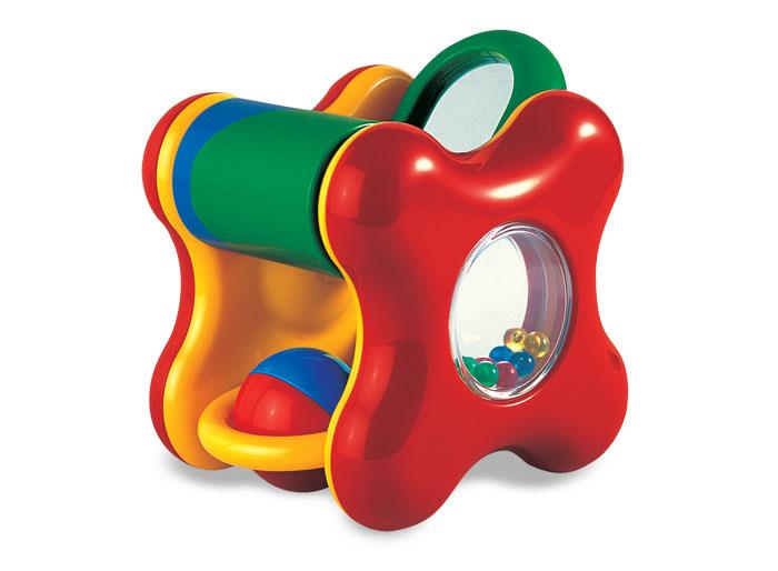 Tolo Classic Игрушка с подвижными элементами89360Игрушка Забавный куб Tolo toys это яркая и многофункциональная игрушка-погремушка для детей от полугода.Эта игрушка будет радовать долгое время любого ребенка. Это целый мини-центр для игр! В ней есть все – и пищалки, и барабан, и перекатывающиеся шарики, и большой мячик, и все это разных цветов! Игрушкой можно греметь, катать шарик, находящийся внутри куба, смотреть на маленькие бусинки (как они здорово скачут в прозрачном окошке), любоваться на себя в маленькое зеркало, расположенное на кубе. А чтобы они учились фокусировать взгляд, концентрировать внимание и уметь захватывать ручками игрушку, бросать ее, пригодятся все остальные функции, а также звуковые эффекты. Яркая игрушка поддержит ребенка в отличном настроении и долго не наскучит, благодаря своему разнообразию!