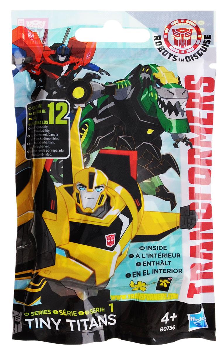 Transformers Мини-фигурка Tiny Titans Series 1B0756EU4Мини-фигурка Transformers Tiny Titans Series 1 привлечет внимание любого маленького поклонника знаменитой серии Трансформеры. Трансформер Мини титан - качественная, детализированная миниатюрная игрушка, созданная в необычном стиле. Каждая мини-фигурка находится в непрозрачной упаковке. Это игрушка-сюрприз, которая дарит радость предвкушения! Также такая фигурка сможет стать отличным началом коллекции. Всего в первой серии выпущено 12 персонажей, среди которых есть самые важные и второстепенные герои из всеми любимой фантастической саги об автоботах и десептиконах. В частности, в коллекции имеются фигурки Бамблби, Оптимуса Прайма, Гримлока и другие трансформеры, как сражающиеся на стороне добра, так и со стороны зла. Ваш ребенок часами будет играть с этой фигуркой, придумывая различные истории. Высокое качество исполнения порадует маленьких и взрослых коллекционеров, и такая фигурка займет достойное место в любой коллекции. Небольшие размеры...