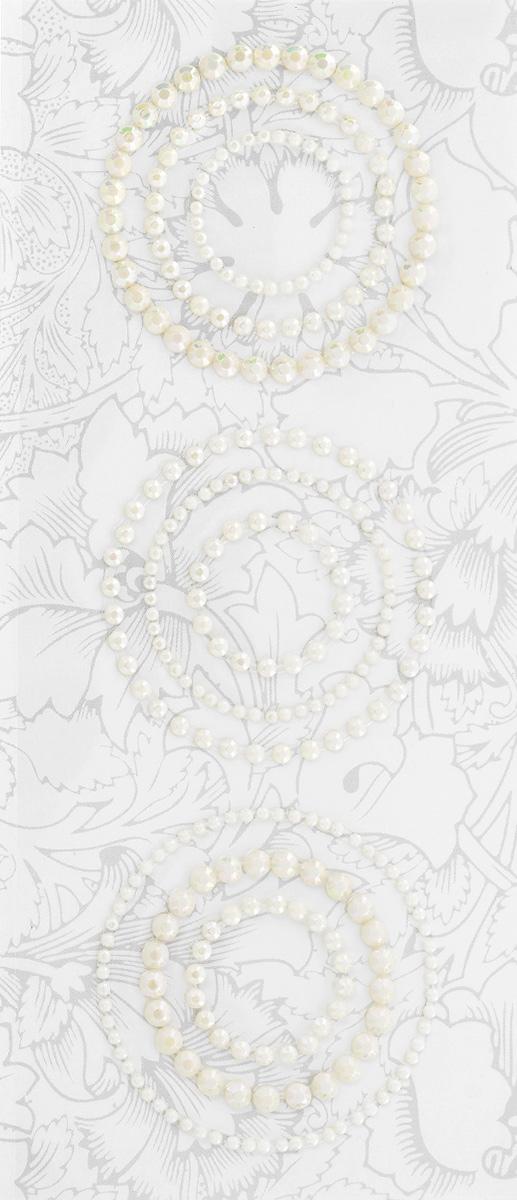 Наклейки декоративные Астра, цвет: молочный, 9 шт. 77083967708396_63639Декоративные наклейки Астра, изготовленные из высококачественного пластика, представлены в виде 9 кругов разных размеров. Изделия оснащены задней клейкой стороной. Такие наклейки подойдут для оформления украшений, бытовой техники, открыток, интерьера и многого другого. Декоративные наклейки помогут добавить оригинальности и эксклюзивности окружающих вас предметов и будут радовать глаз. Средний диаметр наклеек: 3,7 см.