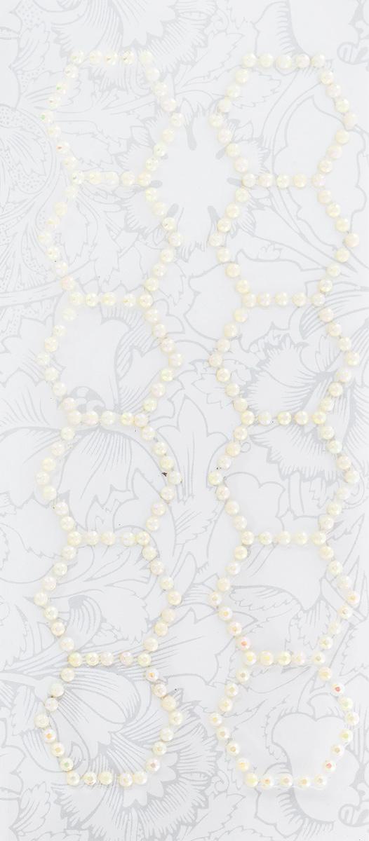 Наклейки декоративные Астра, 2 шт. 77084017708401_63684Декоративные наклейки Астра, изготовленные из высококачественного пластика, представлены в виде 2 полосок со стразами, выложенных по форме многоугольников. Изделия оснащены задней клейкой стороной. Такие наклейки подойдут для оформления украшений, бытовой техники, открыток, интерьера и многого другого. Декоративные наклейки помогут добавить оригинальности и эксклюзивности окружающих вас предметов и будет радовать глаз. Размер наклейки: 15,2 см х 3 см.
