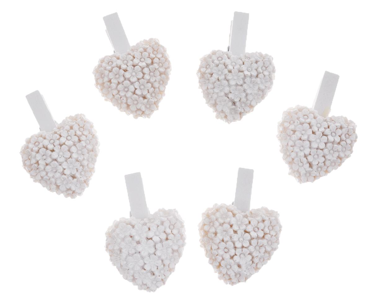 Набор декоративных прищепок Феникс-презент Сердечки, цвет: белый, 6 шт36931Набор Феникс-презент Сердечки состоит из 6 декоративных прищепок, выполненных из дерева. Прищепки оформлены фигурками из полирезины в виде сердец из цветов. Изделия используются для развешивания стикеров на веревке и маленьких игрушек, а оригинальность и веселые цвета прищепок будут радовать глаз и поднимут настроение. Такой набор станет прекрасным дополнением к оформлению вашего интерьера. Длина прищепки: 4,5 см. Размер фигурки: 3,5 см х 3,2 см х 0,7 см.