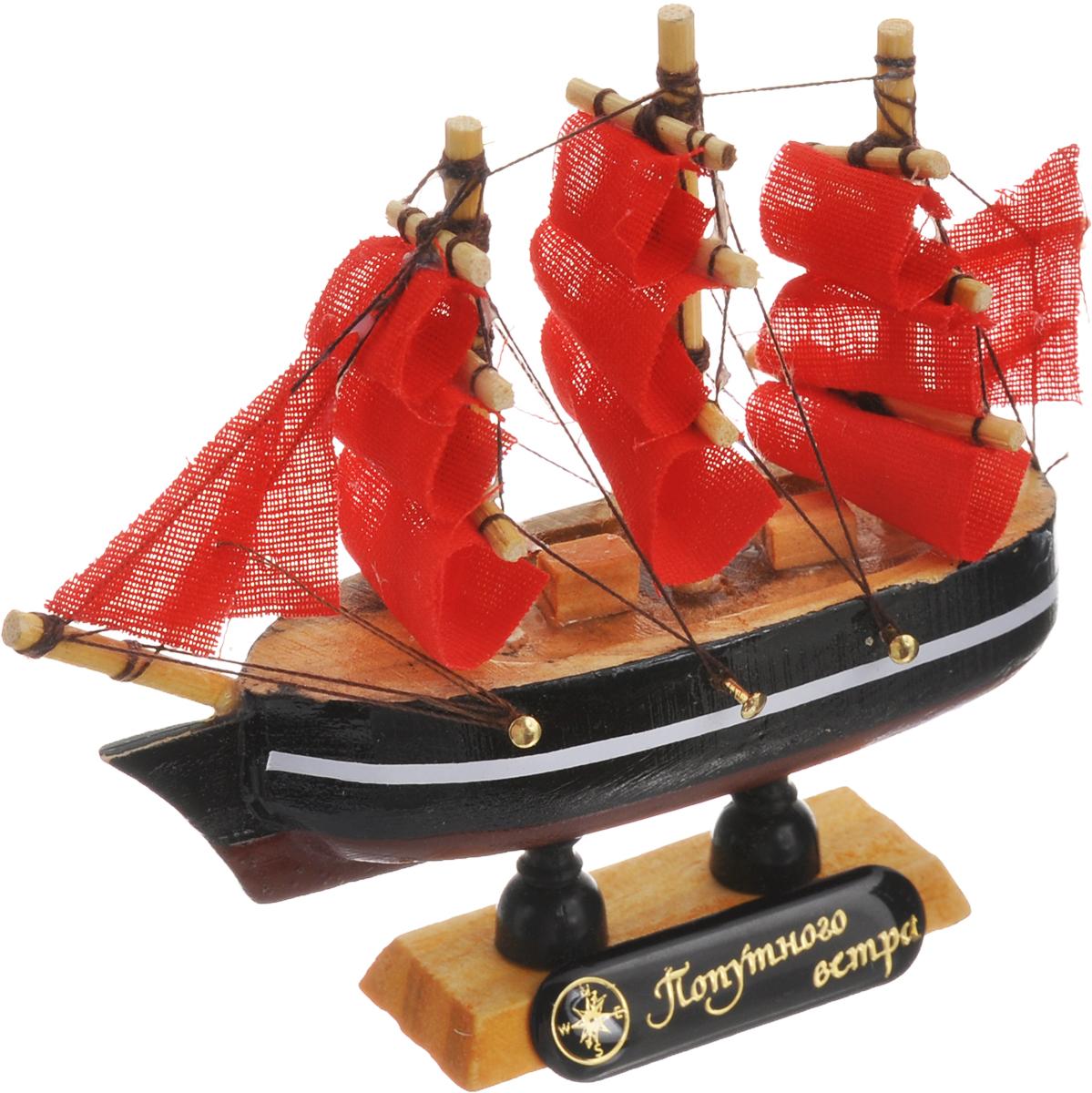 Корабль сувенирный Sima-land Попутного ветра, длина 10 см564160_красный, черныйСувенирный корабль Sima-land Попутного ветра, изготовленный из дерева и текстиля, это великолепный элемент декора рабочей зоны в офисе или кабинете. Корабль с парусами помещен на деревянную подставку. Время идет, и мы становимся свидетелями развития технического прогресса, новых учений и практик. Но одно не подвластно времени - это любовь человека к морю и кораблям. Сувенирный корабль наполнен историей и силой океанских вод. Данная модель кораблика станет отличным подарком для всех любителей морей, поклонников историй о покорении океанов и неизведанных земель. Модель корабля - подарок со смыслом. Издавна на Руси считалось, что корабли приносят удачу и везение. Поэтому их изображения, фигурки и точные копии всегда присутствовали в помещениях. Удивите себя и своих близких необычным презентом.