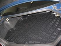 Коврик в багажник Nissan Teana sd (06-) полиуретан0105110101Коврики производятся индивидуально для каждой модели автомобиля из современного и экологически чистого материала, точно повторяют геометрию пола автомобиля, имеют высокий борт от 4 см до 6 см., обладают повышенной износоустойчивостью, антискользящими свойствами, лишены резкого запаха, сохраняют свои потребительские свойства в широком диапазоне температур (-50 +80 С).