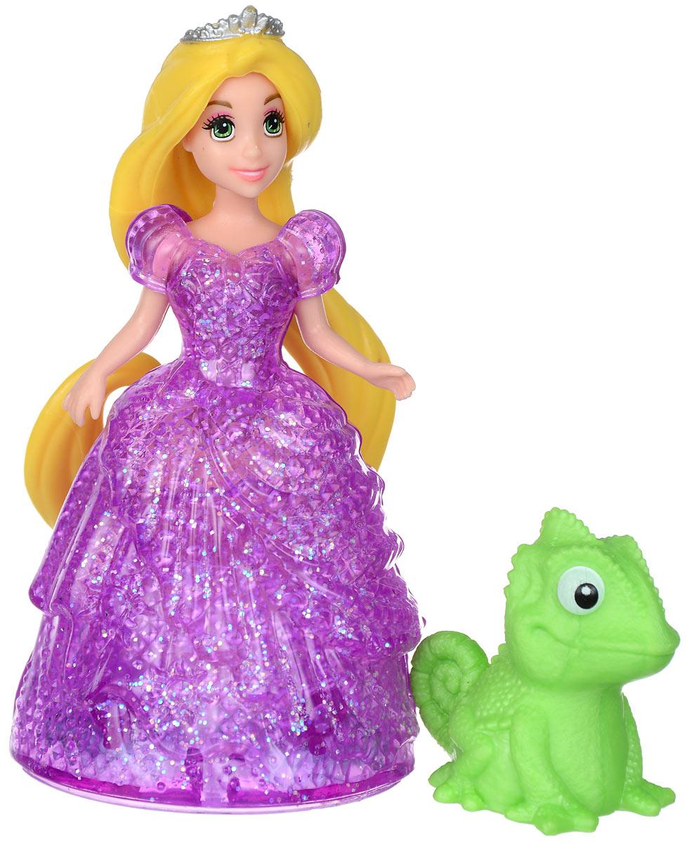 Disney Princess Мини-кукла Принцесса РапунцельBDK11_BDK13Мини-кукла Disney Princess Рапунцель непременно порадует вашу малышку и доставит ей много удовольствия от часов игры. Куколка выполнена в виде героини диснеевского мультфильма Рапунцель. Она одета в яркое фиолетовое платье, выполненное по специальной технологии MagiClip из мягкого пластика, которая позволяет его легко снимать и надевать. Платье красиво переливается, благодаря искрящемуся напылению. Ручки, ножки и голова куколки подвижны. В комплекте с Рапунцель есть и фигурка ее друга - хамелеона Паскаля. В платье Рапунцель вмонтированы небольшие колесики, а в фигурку хамелеона - железный шарик, с помощью которых они могут легко передвигаться. Ваша малышка с удовольствием будет играть с этой куколкой, проигрывая сюжеты из мультфильма или придумывая различные истории.