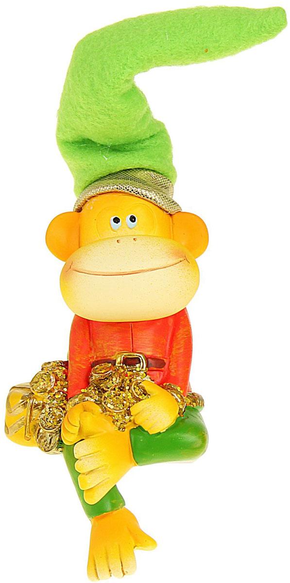 Сувенир Sima-land Обезьянка в колпаке с подарком и монетами, высота 16 см1056318_подарокСувенир Sima-land Обезьянка в колпаке с подарком и монетами выполнен из высококачественного полистоуна в виде забавной обезьянки в текстильном колпаке. Такой сувенир станет отличным подарком родным или друзьям на Новый год, а также он украсит интерьер вашего дома или офиса.