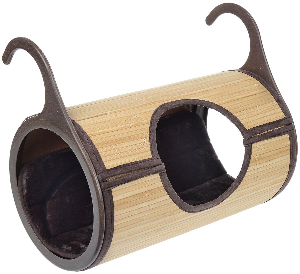 Лежанка на радиатор отопления Fauna Arlette, 28 см х 40 см х 47,5 смFICR-1214Лежанка Fauna Arlette изготовлена из природного материала - бамбуковых листьев. Крепится на радиатор при помощи двух пластиковых крючков. В комплекте - удобная меховая подушка. Изделие легко собирается и быстро разбирается. Подарите вашей кошке тепло бамбукового леса! Природные материалы и форма раскроют инстинкты вашего питомца и сделают его игры увлекательнее, а сон спокойнее. Размер подушки: 46,5 см х 33 см.