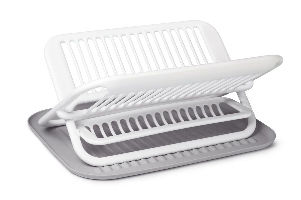Сушилка для посуды SiliconeZone, цвет: белый, серый, 47,5 х 35,5 х 22 смSZ11-KS-11648-ABСтильная и функциональная сушилка для посуды изготовлена из пищевого пластика и силикона. Столовые приборы могут быть помещены в специальную нишу. Силиконовый коврик предназначен для стекающей воды с посуды. При необходимости сушилку легко сложить. Размер сушилки: 35,5 х 46,9 х 22 см. Размер коврика: 47,5 х 35,5 х 1,7 см