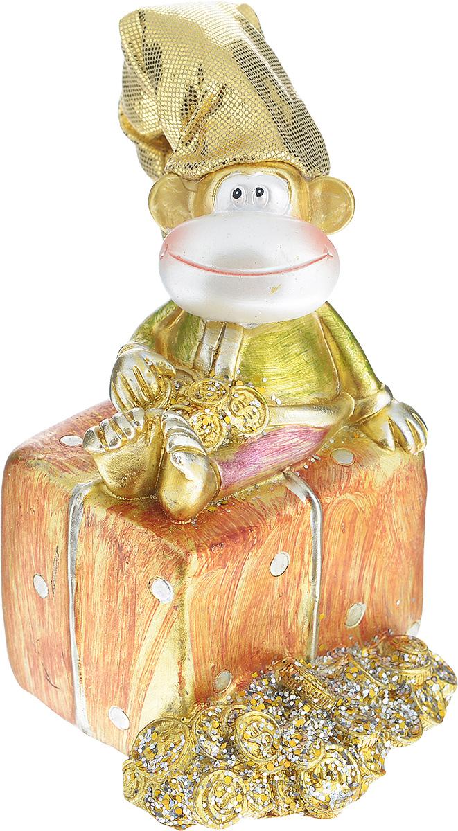 Копилка декоративная Sima-land Обезьянка на подарке1056322Декоративная копилка Sima-land Обезьянка на подарке, изготовленная из высококачественного полистоуна, выполнена в виде обезьяны в текстильном колпаке и украшена блестками. Изделие оснащено отверстием для монет и резиновым клапаном, через который можно достать деньги. Яркий оригинальный дизайн сделает такую копилку прекрасным подарком. Она послужит не только по своему прямому назначению, но и красиво дополнит интерьер комнаты.