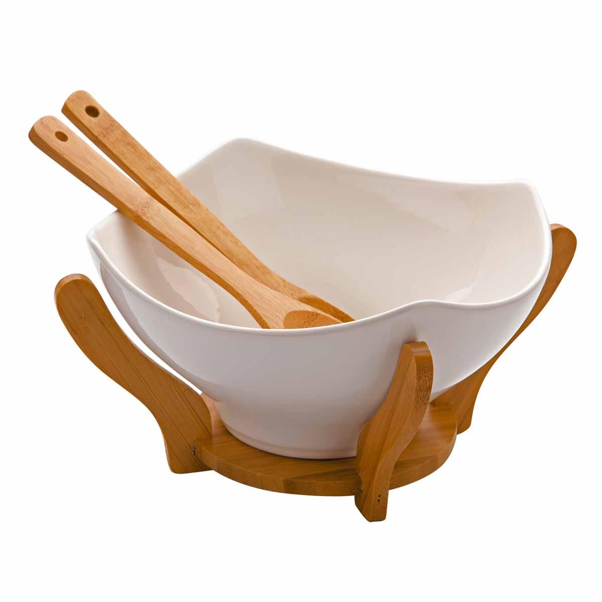 Салатница Dekok, с 2 ложками, с подставкой, 23,5 х 23,5 смPW-2711Салатница Dekok изготовлена из фарфора и имеет оригинальную форму. Посуда безопасна для здоровья и окружающей среды. Изделие размещено на подставке, выполненной из бамбука. Такая салатница прекрасно подходит для различных блюд: каш, хлопьев, салатов и многого другого. Она дополнит коллекцию вашей кухонной посуды и будет служить долгие годы. В наборе - 2 деревянные сервировочные ложки. Размер салатницы (по верхнему краю): 23,5 см х 23,5 см. Высота стенки салатницы: 12 см. Длина ложек: 26 см. Размер рабочей части ложек: 6 см х 8,5 см. Размер подставки: 21 см х 21 см х 11,6 см.