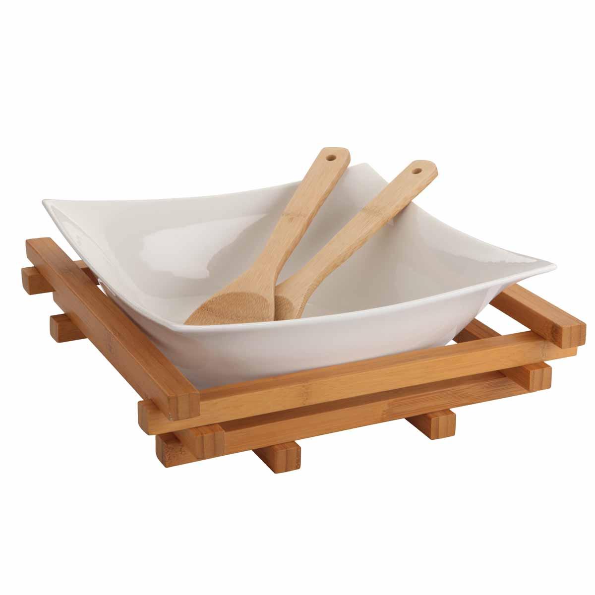 Салатница Dekok, с 2 ложками, с подставкой, 25 см х 25 смPW-2712Салатница Dekok изготовлена из фарфора и имеет оригинальную форму. Посуда безопасна для здоровья и окружающей среды. Изделие размещено на подставке, выполненной из бамбука. Такая салатница прекрасно подходит для различных блюд: хлопьев, салатов и многого другого. Она дополнит коллекцию вашей кухонной посуды и будет служить долгие годы. В наборе - 2 сервировочные ложки, выполненные из бамбука. Размер салатницы (по верхнему краю): 25 см х 25 см. Высота стенки салатницы: 9,5 см. Длина ложек: 29,5 см. Размер рабочей части ложек: 6 см х 8,5 см. Размер подставки: 28 см х 28 см х 7,6 см.
