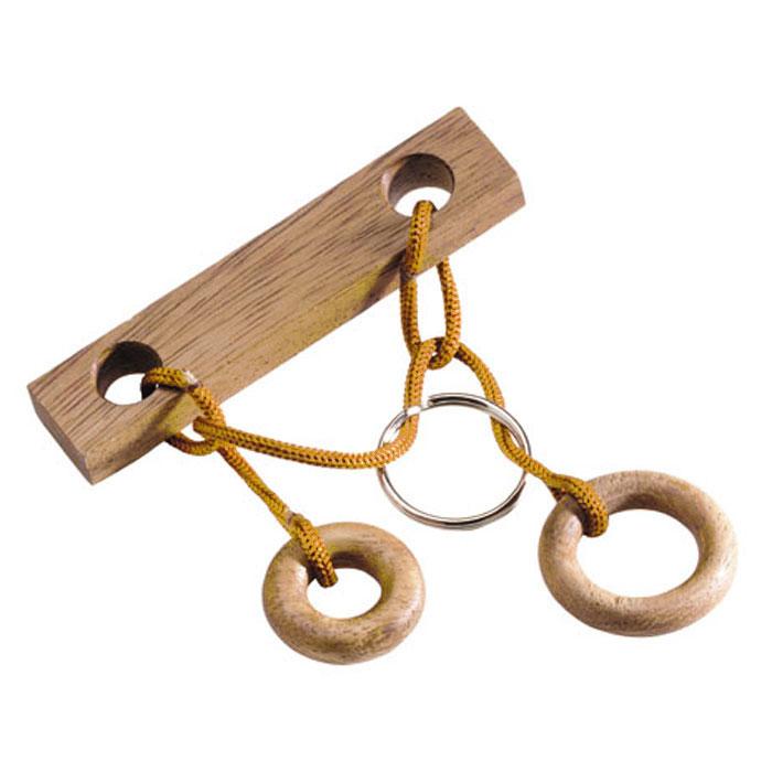 Dilemma Головоломка Кольцо на брускеIQ862Головоломка Dilemma Кольцо на бруске, выполненная из дерева, текстиля и металла, станет отличным подарком всем любителям головоломок! Освободите серебряное кольцо. Использование ножниц запрещено... Получилось? Попробуйте вернуть кольцо обратно. Слишком сложно? Воспользуйтесь подсказкой из предложенного решения. Игра рассчитана на одного игрока. Головоломка Dilemma Кольцо на бруске стимулирует логику, пространственное мышление и мелкую моторику рук.