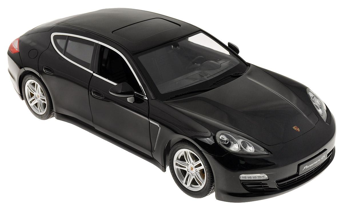 Rastar Радиоуправляемая модель Porsche Panamera цвет черный52400Радиоуправляемая модель Rastar Porsche Panamera станет отличным подарком любому мальчику! Все дети хотят иметь в наборе своих игрушек ослепительные, невероятные и крутые автомобили на радиоуправлении. Тем более, если это автомобиль известной марки с проработкой всех деталей, удивляющий приятным качеством и видом. Одной из таких моделей является автомобиль на радиоуправлении Rastar Porsche Panamera. Это точная копия настоящего авто в масштабе 1:10. Передние двери машины открываются. Возможные движения: вперед, назад, вправо, влево, остановка. Имеются световые эффекты. Пульт управления работает на частоте 27 MHz. Игрушка работает на сменном аккумуляторе (входит в комплект). Для работы пульта управления необходима 1 батарейка 9V (6F22) (не входит в комплект).