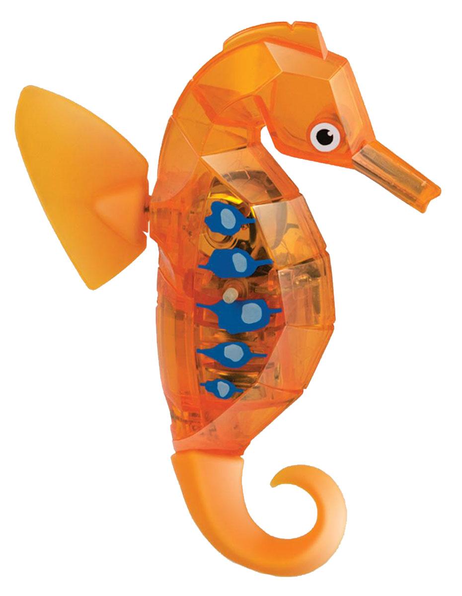 Hexbug Микро-робот Морской конек цвет оранжевый460-4088Hexbug Seahorse (Морской конек) - это новинка в линейке Aquabot. Микро-робот Морской конек плавает в толще воды, время от времени погружается глубже и всплывает к поверхности, светится встроенным светодиодом. Через пять минут засыпает и уходит в сон, для продолжения игры нужно постучать по аквариуму или вынуть игрушку из воды и погрузить снова. Умная технология, воплощенная в микророботах Hexbug, позволяет без проблем содержать водных обитателей у себя дома или в офисе, украсив комнату или сделав детскую игру еще более занимательной. Подарите другу оригинального микроробота или познакомьте своего ребенка с животным миром тропических морей: морской конек понравится всем. Просто опустите своего питомца в воду, и он моментально задвигает своими плавничками, а спустя пять минут самостоятельно остановится, и оживет от стука по стенке аквариума. Забавный микроробот работает от двух батареек AG-13, которые входят в комплект.