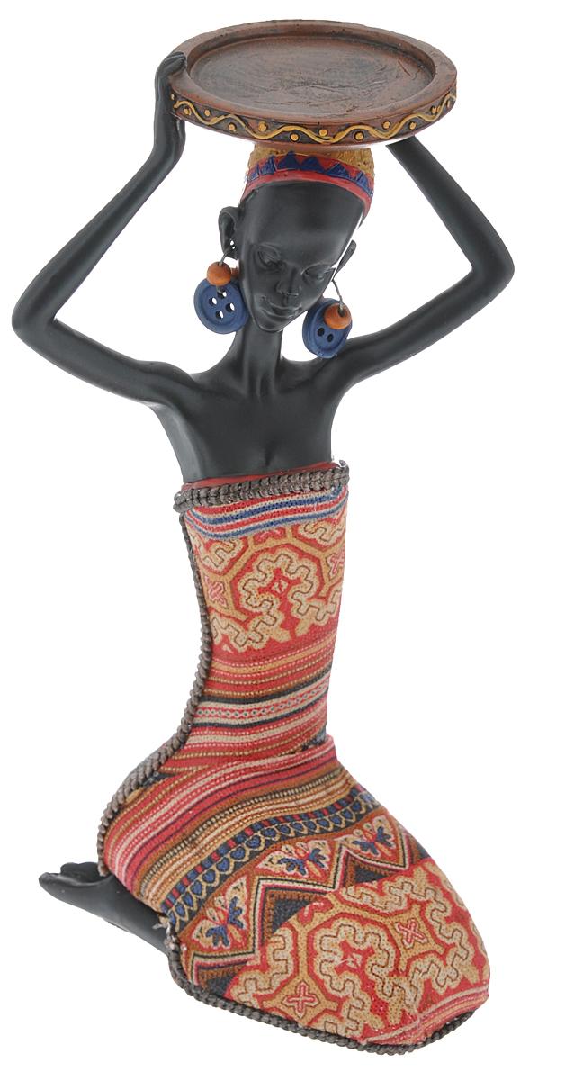 Декоративная фигурка Феникс-презент Африканка в красном, высота 19 см37916Декоративная фигурка Африканка в красном, изготовленная из полирезины, достойно украсит интерьер вашего дома или офиса. Она выполнена в виде африканской девушки в национальной одежде с подносом на голове. Вы можете поставить украшение в любом месте, где оно будет удачно смотреться и радовать глаз. Кроме того, это отличный вариант подарка для ваших близких и друзей.