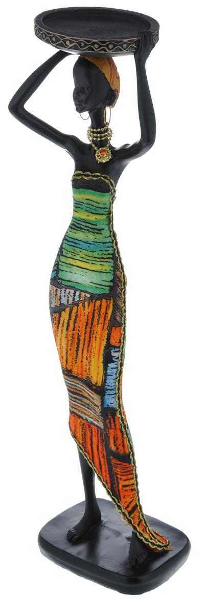 Декоративная фигурка Феникс-презент Африканка с подносом, высота 37 см37912Декоративная фигурка Африканка с подносом, изготовленная из полирезины, достойно украсит интерьер вашего дома или офиса. Она выполнена в виде африканской девушки в национальной одежде с подносом на голове. Вы можете поставить украшение в любом месте, где оно будет удачно смотреться и радовать глаз. Кроме того, это отличный вариант подарка для ваших близких и друзей.