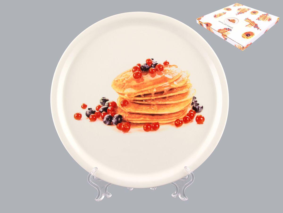 Тарелка для блинов Elan Gallery Блины с ягодами, диаметр 25 см101170Круглая тарелка Elan Gallery Блины с ягодами, изготовленная из керамики и декорированная ярким и аппетитным изображением, позволит красиво подать блины. Такая тарелка украсит сервировку вашего стола и подчеркнет прекрасный вкус хозяина, а также станет отличным подарком. Диаметр: 25 см. Высота: 2 см.