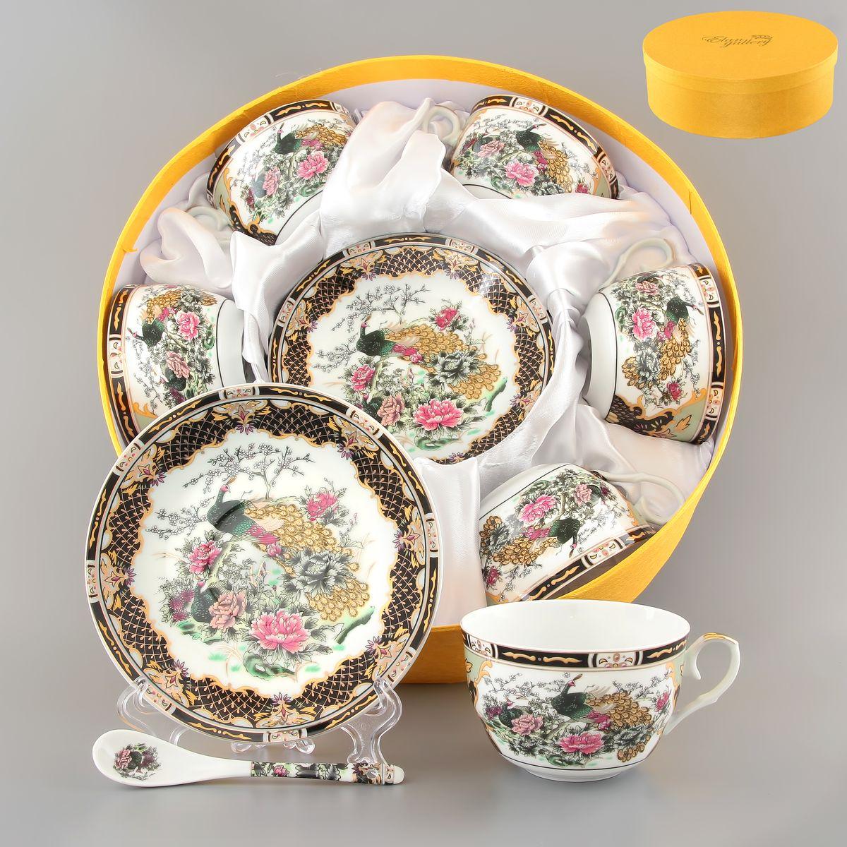 Набор чайный Elan Gallery Павлин на золоте, 18 предметов180786Чайный набор Elan Gallery Павлин на золоте состоит из 6 чашек, 6 блюдец и 6 ложек. Изделия, выполненные из высококачественной керамики, имеют элегантный дизайн и классическую форму. Такой набор прекрасно подойдет как для повседневного использования, так и для праздников. Чайный набор Elan Gallery Павлин на золоте - это не только яркий и полезный подарок для родных и близких, это также великолепное дизайнерское решение для вашей кухни или столовой. Не использовать в микроволновой печи. Объем чашки: 250 мл. Диаметр чашки (по верхнему краю): 9,5 см. Высота чашки: 6 см. Диаметр блюдца (по верхнему краю): 14 см. Высота блюдца: 2 см. Длина ложки: 12,5 см.