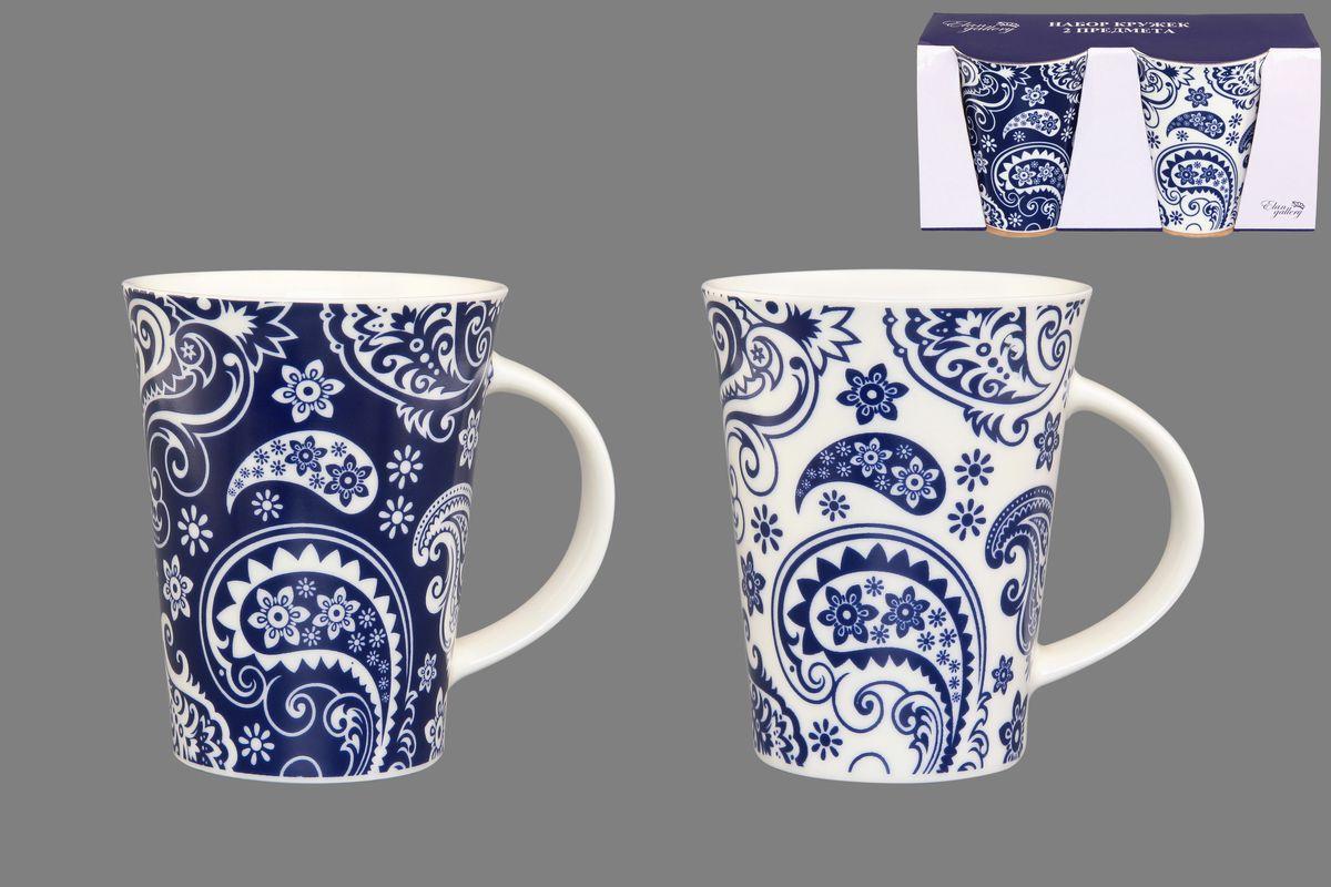 Набор кружек Elan Gallery Пейсли, цвет: белый, синий, 320 мл, 2 шт250079Набор Elan Gallery Пейсли состоит из двух кружек, выполненных из керамики. Этот необычный набор станет великолепным подарком для каждого и, несомненно, вызовет восхищение. Объем кружек: 320 мл. Диаметр кружек (по верхнему краю): 8,5 см. Высота кружек: 11 см. Не рекомендуется применять абразивные моющие средства. Не использовать в микроволновой печи.