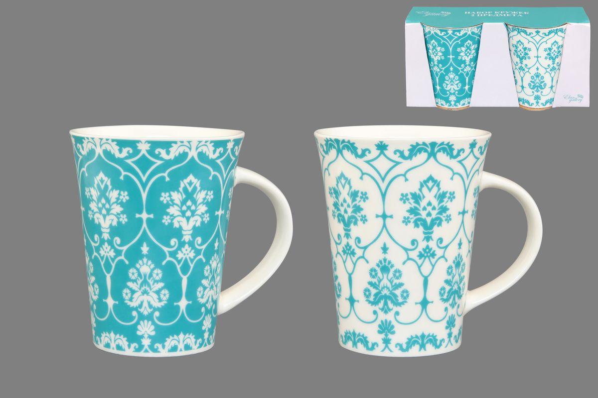 Набор кружек Elan Gallery Дамаск, цвет: белый, бирюзовый, 320 мл, 2 шт250080Набор Elan Gallery Дамаск состоит из двух кружек, выполненных из керамики. Этот необычный набор станет великолепным подарком для каждого и, несомненно, вызовет восхищение. Объем кружек: 320 мл. Диаметр кружек (по верхнему краю): 8,5 см. Высота кружек: 11 см. Не рекомендуется применять абразивные моющие средства. Не использовать в микроволновой печи.