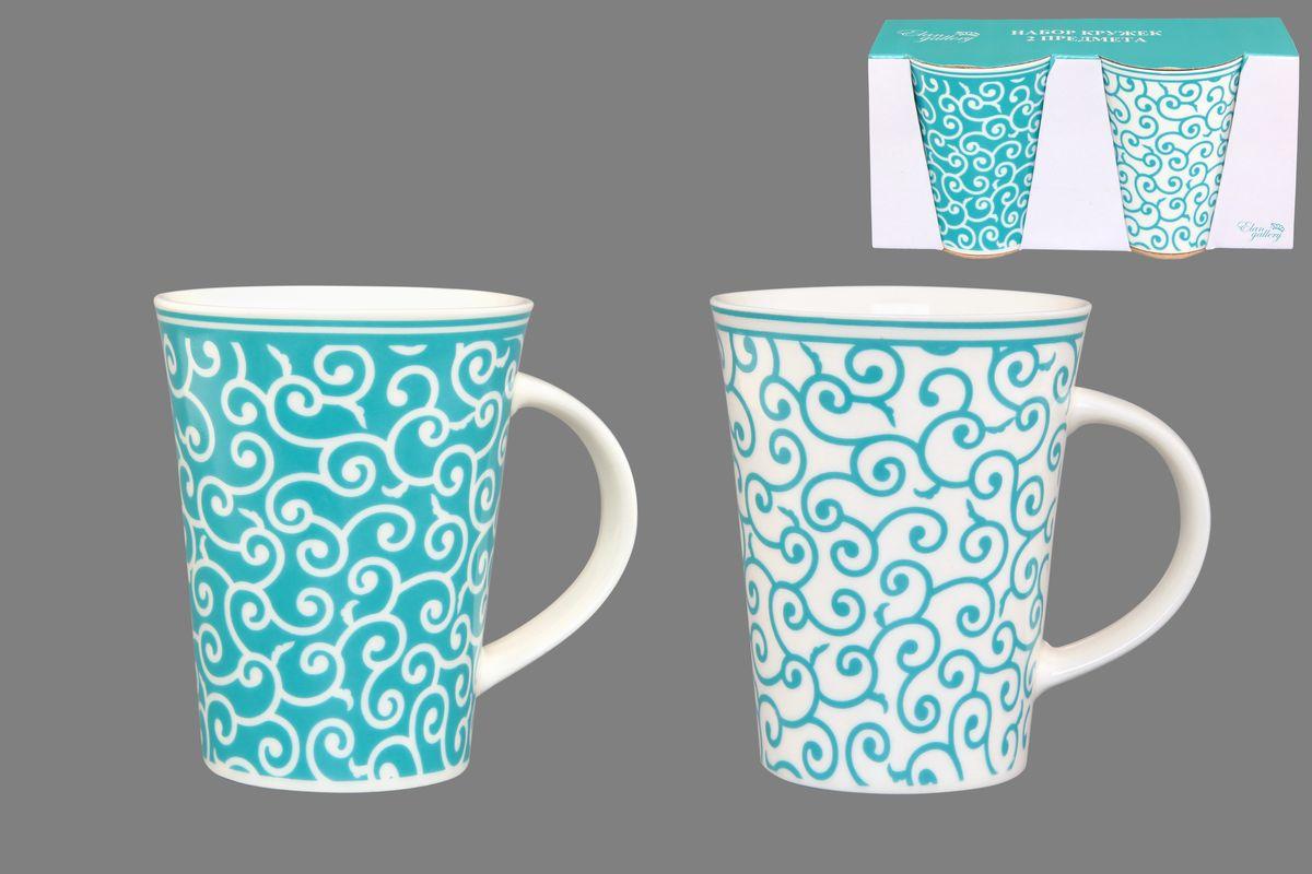 Набор кружек Elan Gallery Арабески, цвет: белый, бирюзовый, 320 мл, 2 шт250081Набор Elan Gallery Арабески состоит из двух кружек, выполненных из керамики. Этот необычный набор станет великолепным подарком для каждого и, несомненно, вызовет восхищение. Объем кружек: 320 мл. Диаметр кружек (по верхнему краю): 8,5 см. Высота кружек: 11 см. Не рекомендуется применять абразивные моющие средства. Не использовать в микроволновой печи.