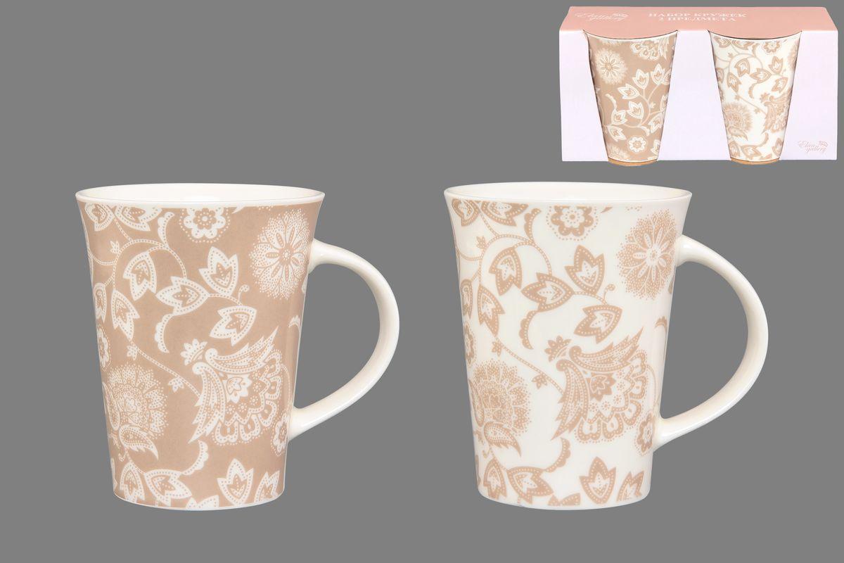 Набор кружек Elan Gallery Изящные цветы, цвет: белый, бежевый, 320 мл, 2 шт250083Набор Elan Gallery Изящные цветы состоит из двух кружек, выполненных из керамики. Этот необычный набор станет великолепным подарком для каждого и, несомненно, вызовет восхищение. Объем кружек: 320 мл. Диаметр кружек (по верхнему краю): 8,5 см. Высота кружек: 11 см. Не рекомендуется применять абразивные моющие средства. Не использовать в микроволновой печи.