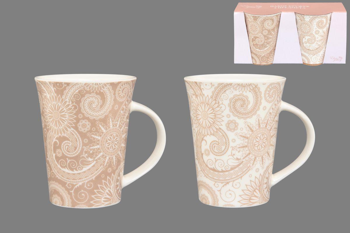 Набор кружек Elan Gallery Цветы и завитушки, цвет: белый, бежевый, 320 мл, 2 шт250084Набор Elan Gallery Цветы и завитушки состоит из двух кружек, выполненных из керамики. Этот необычный набор станет великолепным подарком для каждого и, несомненно, вызовет восхищение. Объем кружек: 320 мл. Диаметр кружек (по верхнему краю): 8,5 см. Высота кружек: 11 см. Не рекомендуется применять абразивные моющие средства. Не использовать в микроволновой печи.