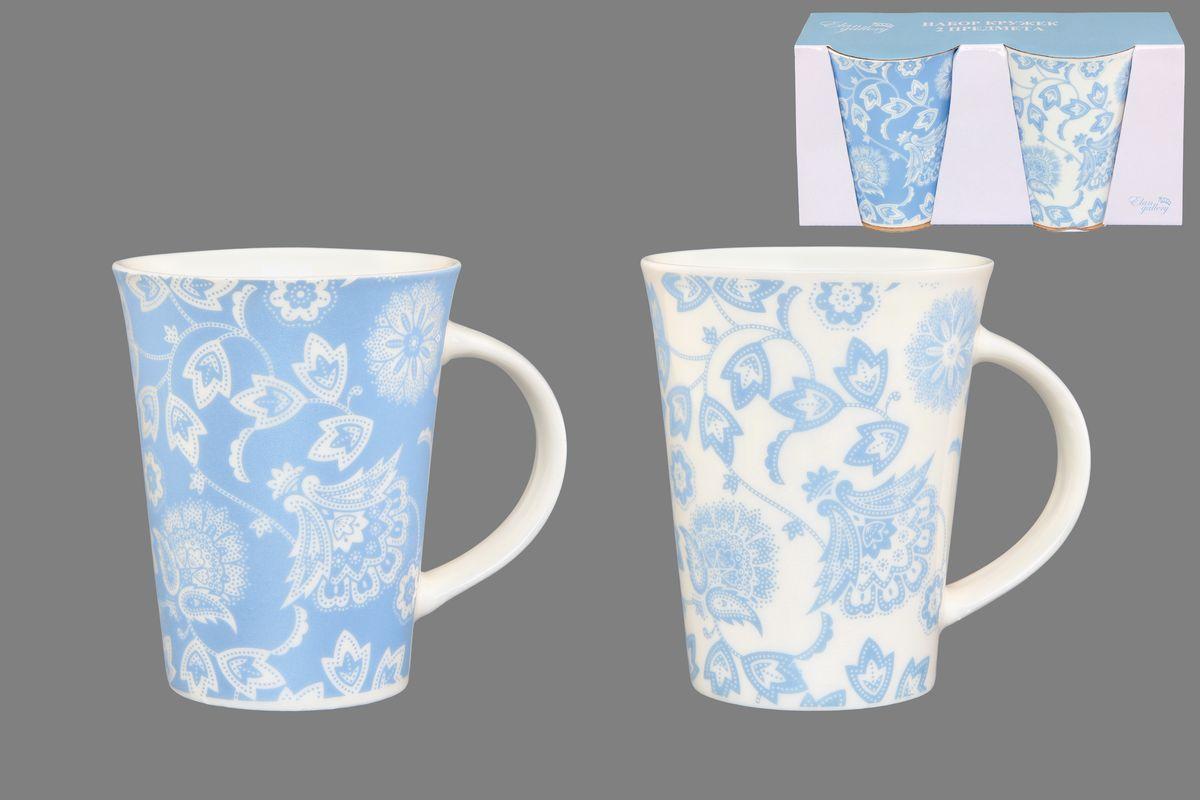 Набор кружек Elan Gallery Изящные цветы, цвет: белый, голубой, 320 мл, 2 шт250085Набор Elan Gallery Изящные цветы состоит из двух кружек, выполненных из керамики. Этот необычный набор станет великолепным подарком для каждого и, несомненно, вызовет восхищение. Объем кружек: 320 мл. Диаметр кружек (по верхнему краю): 8,5 см. Высота кружек: 11 см. Не рекомендуется применять абразивные моющие средства. Не использовать в микроволновой печи.