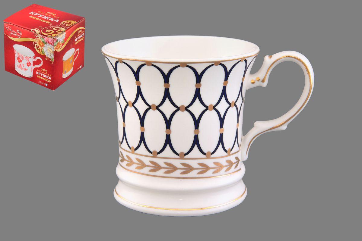 Кружка Elan Gallery Синий узор, цвет: белый, синий, золотистый, 170 мл730399Кружка Elan Gallery Синий узор выполнена из керамики и оформлена узорами в виде синих колец. Она станет отличным дополнением к сервировке семейного стола и замечательным подарком для ваших родных и друзей. Диаметр кружки по верхнему краю: 7,5 см. Высота кружки: 7,5 см. Не рекомендуется применять абразивные моющие средства. Не использовать в микроволновой печи.