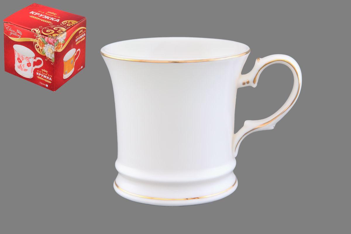 Кружка Elan Gallery Снежинка, цвет: белый, золотистый, 170 мл730418Кружка Elan Gallery Снежинка выполнена из керамики. Она станет отличным дополнением к сервировке семейного стола и замечательным подарком для ваших родных и друзей. Диаметр кружки по верхнему краю: 7,5 см. Высота кружки: 7,5 см. Не рекомендуется применять абразивные моющие средства. Не использовать в микроволновой печи.