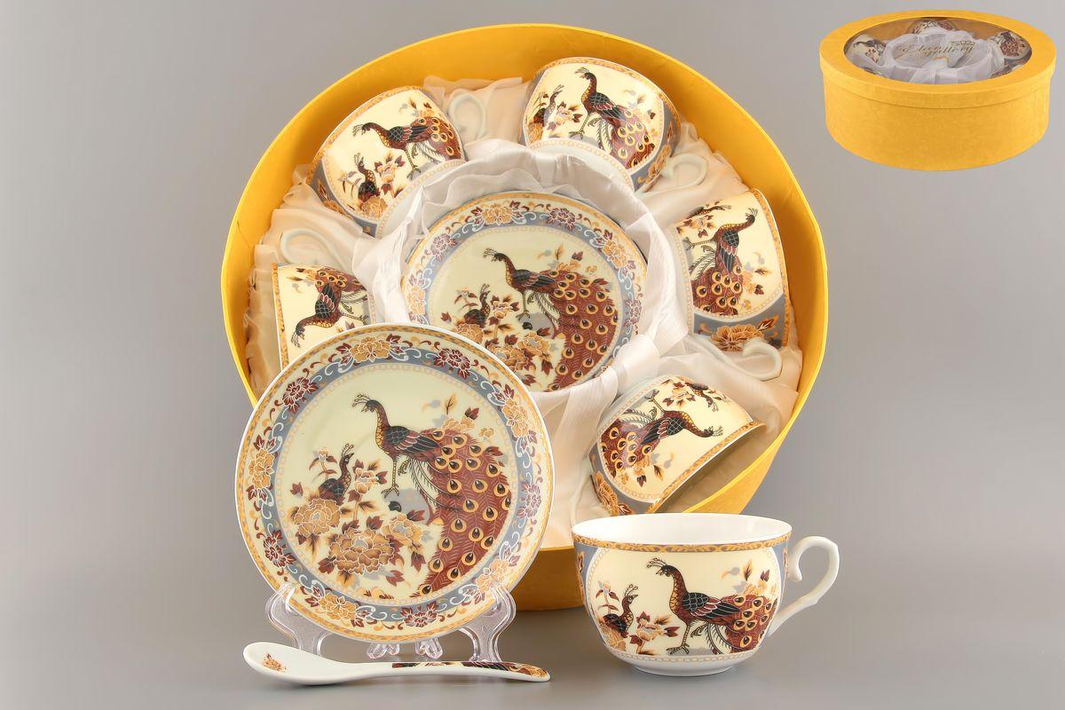 Набор чайный Elan Gallery Павлин на бежевом, 18 предметов730473Чайный набор Elan Gallery Павлин на бежевом состоит из шести чашек, шести блюдец и шести чайных ложек, изготовленных из высококачественной керамики Предметы набора оформлены изящным и ярким рисунком. Чайный набор Elan Gallery Павлин на бежевом украсит ваш кухонный стол, а также станет замечательным подарком друзьям и близким. Не рекомендуется использовать в микроволновой печи. Не применять абразивные моющие вещества. Объем чашки: 250 мл. Диаметр чашки по верхнему краю: 9,5 см. Высота чашки: 6 см. Диаметр блюдца: 14 см. Высота блюдца: 2,2 см. Длина ложки: 13 см.