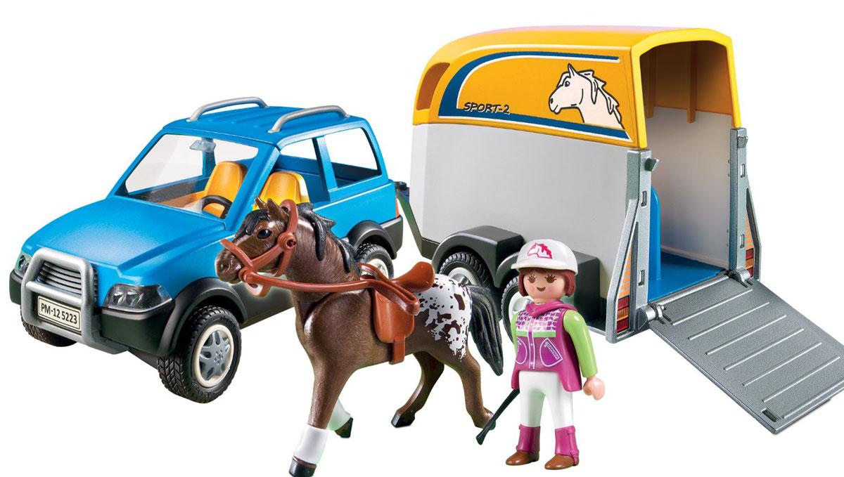 Playmobil Игровой набор Лошади Джип с трейлером для перевозки лошадей5223pmИгровой набор Playmobil Лошади: Джип с трейлером для перевозки лошадей. Он точно пригодится для организации интересной игры, ведь с его помощью можно будет безопасно перевозить животных на большие расстояния для участия в соответствующих конных соревнованиях. В комплект входит: наездник, попон, седло для лошади, стек и шапочка наездника, джип с трейлером, фигурка лошади, машина. Ваш ребенок будет часами играть с этой игрушкой, придумывая различные истории. Порадуйте его таким замечательным подарком!