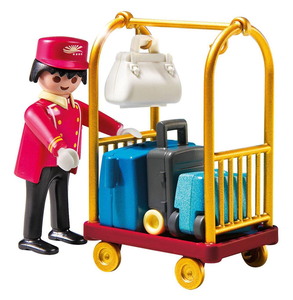 Playmobil Игровой набор Отель Носильщик с чемоданами5270pmИгровой набор Playmobil Отель: Носильщик с чемоданами – это интересный и увлекательный игровой конструктор, который порадует любого ребенка. Фигурка приветливого носильщика, одетого в специальную униформу, разнообразит действия и сюжет захватывающей игры. В набор входит: две дорожные сумки, большой чемодан с выдвижной ручкой, тележка на колесиках. Игровые наборы Playmobil помогают детям освоить особенности новой для них профессии, учат вежливости, этикету и приему гостей.