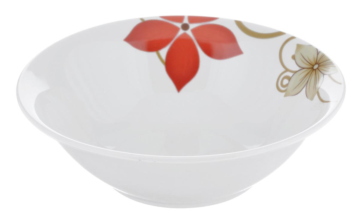Салатница Dasen Магнолия, диаметр 14 смDNDS-9000-4Салатница Dasen Магнолия, изготовленная из высококачественного фаянса, предназначена для красивой подачи различных блюд. Изделие украшено ярким красочным рисунком. Такая салатница украсит сервировку стола и подчеркнет прекрасный вкус хозяйки. Можно мыть в посудомоечной машине и использовать в микроволновой печи. Диаметр: 14 см. Высота: 4,5 см.