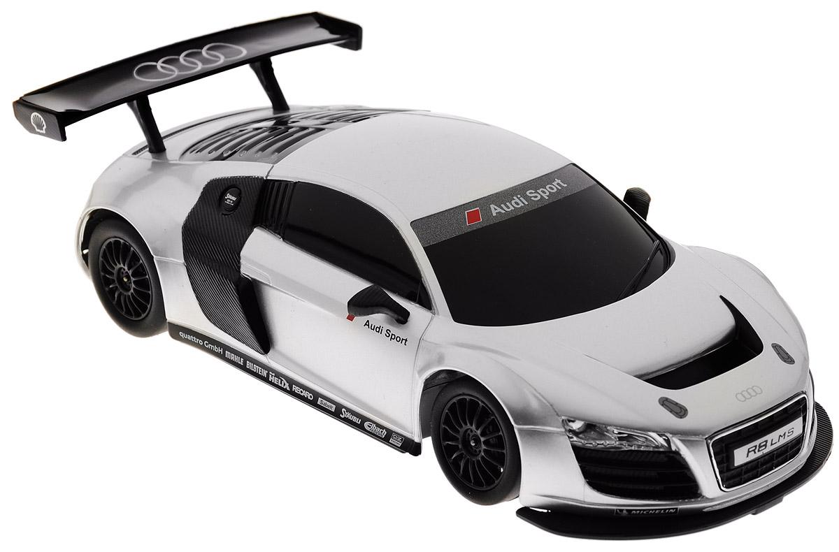 Rastar Радиоуправляемая модель Audi R8 LMS цвет серебристый черный46800Радиоуправляемая модель Rastar Audi R8 LMS станет отличным подарком любому мальчику! Все дети хотят иметь в наборе своих игрушек ослепительные, невероятные и крутые автомобили на радиоуправлении. Тем более, если это автомобиль известной марки с проработкой всех деталей, удивляющий приятным качеством и видом. Одной из таких моделей является автомобиль на радиоуправлении Rastar Audi R8 LMS. Это точная копия настоящего авто в масштабе 1:24. Возможные движения: вперед, назад, вправо, влево, остановка. Имеются световые эффекты. Пульт управления работает на частоте 40 MHz. Для работы игрушки необходимы 3 батарейки типа АА (не входят в комплект). Для работы пульта управления необходимы 2 батарейки типа АА (не входят в комплект).
