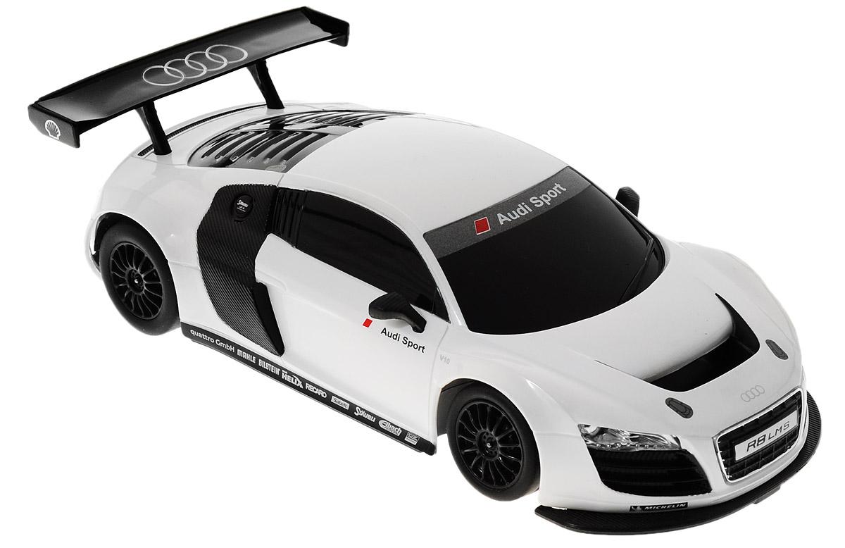 Rastar Радиоуправляемая модель Audi R8 LMS цвет белый черный46800_белыйРадиоуправляемая модель Rastar Audi R8 LMS станет отличным подарком любому мальчику! Все дети хотят иметь в наборе своих игрушек ослепительные, невероятные и крутые автомобили на радиоуправлении. Тем более, если это автомобиль известной марки с проработкой всех деталей, удивляющий приятным качеством и видом. Одной из таких моделей является автомобиль на радиоуправлении Rastar Audi R8 LMS. Это точная копия настоящего авто в масштабе 1:24. Возможные движения: вперед, назад, вправо, влево, остановка. Имеются световые эффекты. Пульт управления работает на частоте 27 MHz. Для работы игрушки необходимы 3 батарейки типа АА (не входят в комплект). Для работы пульта управления необходимы 2 батарейки типа АА (не входят в комплект).