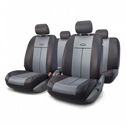 Авточехлы Autoprofi TT, цвет: черный, серый, 9 предметов. TT-902P BK/D.GYTT-902P BK/D.GYАвтомобильные чехлы Autoprofi TT изготавливаются из высококачественного полиэстера со вставками из поролона, обеспечивающего сцепление с сиденьем. Мягкие чехлы являются отличным дополнением салона любого автомобиля. Изделия придают автомобильному интерьеру современные и солидные черты. Универсальная конструкция подходит для большинства автомобильных сидений. Подходят для автомобилей с боковыми подушками безопасности (распускаемый шов). Специальные молнии, расположенные в чехлах спинки заднего ряда, позволяют использовать чехлы на автомобилях с различными пропорциями складывания заднего ряда. Комплектация: 5 подголовников, 2 чехла сидений переднего ряда, 1 спинка заднего ряда, 1 сиденье заднего ряда.