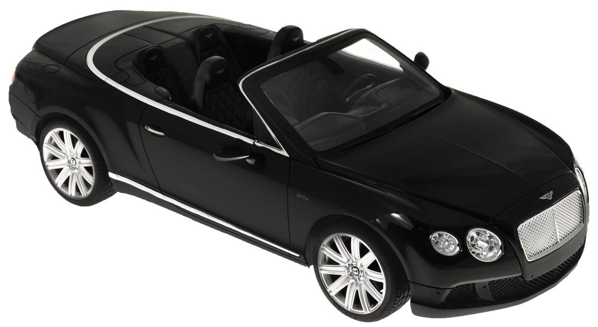 Rastar Радиоуправляемая модель Bentley Continental GT Speed Convertible цвет черный49900_черныйРадиоуправляемая модель Rastar Bentley Continental GT Speed Convertible станет отличным подарком любому мальчику! Все дети хотят иметь в наборе своих игрушек ослепительные, невероятные и крутые автомобили на радиоуправлении. Тем более, если это автомобиль известной марки с проработкой всех деталей, удивляющий приятным качеством и видом. Одной из таких моделей является автомобиль на радиоуправлении Rastar Bentley Continetal GT Speed Convertible. Это точная копия настоящего авто в масштабе 1:12. Авто обладает неповторимым провокационным стилем и спортивным характером. Потрясающая маневренность, динамика и покладистость - отличительные качества этой модели. Возможные движения: вперед, назад, вправо, влево, остановка. Имеются световые эффекты. Пульт управления работает на частоте 27 MHz. Для работы игрушки необходимы 5 батареек типа АА (не входят в комплект). Для работы пульта управления необходима 1 батарейка 9V (6F22) (не входит в комплект).