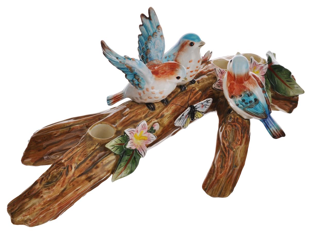Подсвечник декоративный Fitz and Floyd Toulouse, 41 см х 19 см х 16 см20-488Подсвечник Fitz and Floyd Toulouse выполнен из высококачественной керамики и предназначен для трех узких свечей. Изделие выполнено в виде композиции из ветки дерева и трех птиц. Такой подсвечник подойдет для декора интерьера дома или офиса. Кроме того, это отличный вариант подарка для ваших близких и друзей. Диаметр отверстия для свечи: 2,2 см.