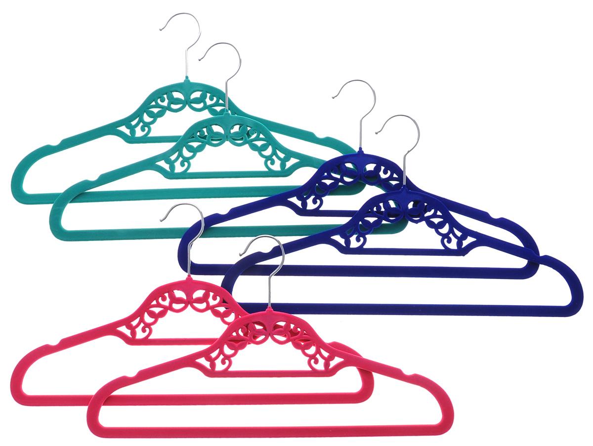 Набор вешалок El Casa, цвет: розовый, зеленый, синий, 6 шт150029Набор вешалок El Casa состоит из 6 разноцветных вешалок, изготовленных из пластика c велюровым антискользящим покрытием. Изделия имеют легкий и прочный каркас, вращающийся крючок, перекладину и две выемки для юбок или маечек. Вешалка - это незаменимая вещь для того, чтобы ваша одежда всегда оставалась в хорошем состоянии. Набор El Casa станет практичным и полезным в вашем гардеробе. С ним ваша одежда избежит ненужных растяжек и провисаний. Комплектация: 6 шт. Размер вешалки: 41,5 см х 0,5 см х 23 см.