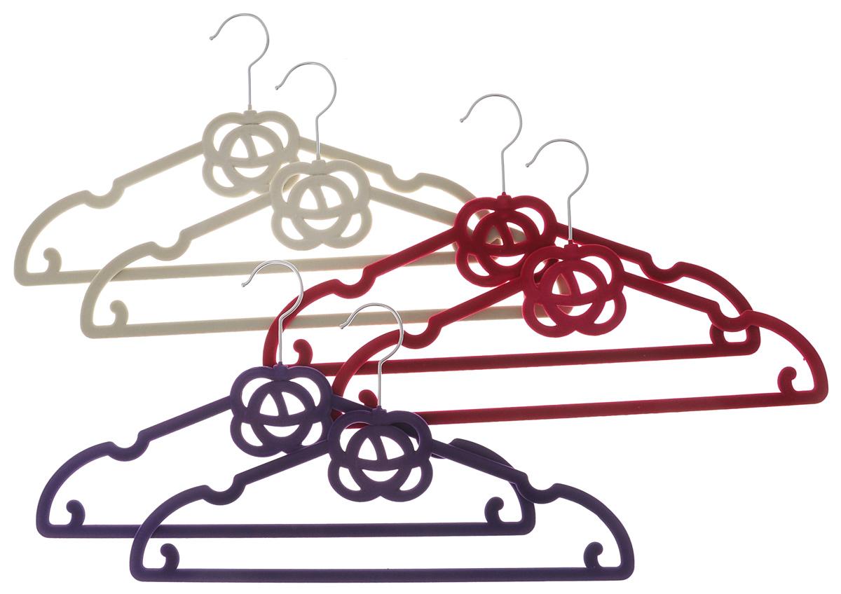 Набор вешалок El Casa Розочки, цвет: фиолетовый, малиновый, молочный, 6 шт150016Набор вешалок El Casa Розочки состоит из 6 разноцветных вешалок, изготовленных из пластика c велюровым антискользящим покрытием. Изделия имеют легкий и прочный каркас, вращающийся крючок, перекладину и выемки для юбок или маечек. Вешалка - это незаменимая вещь для того, чтобы ваша одежда всегда оставалась в хорошем состоянии. Набор El Casa Розочки станет практичным и полезным в вашем гардеробе. С ним ваша одежда избежит ненужных растяжек и провисаний. Комплектация: 6 шт. Размер вешалки: 40 см х 0,5 см х 22,5 см.