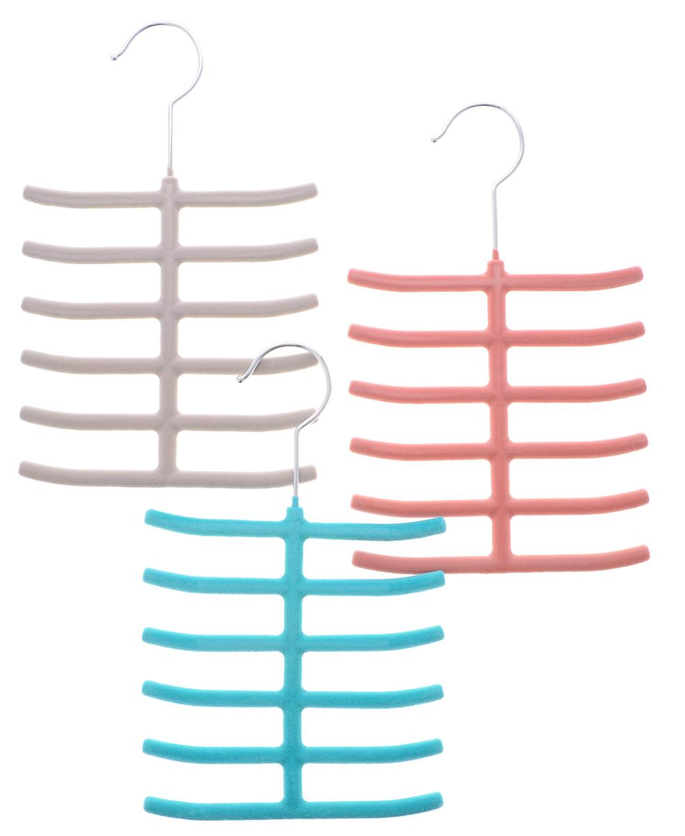 Набор вешалок для аксессуаров El Casa, цвет: бирюзовый, темно-розовый, светло-серый, ширина 16 см, 3 шт150039Набор разноцветных вешалок El Casa, изготовленный из пластика, имеет велюровое антискользящее покрытие. Благодаря перекладине и выемкам изделия подходят для универсального использования. Они безупречно справятся с хранением не только мужских, но и женских аксессуаров. Вешалка - это незаменимая вещь для того, чтобы ваша одежда всегда оставалась в хорошем состоянии. Комплектация: 3 шт. Размер вешалки (ВхДхШ): 26 см х 16 см х 0,8 см.