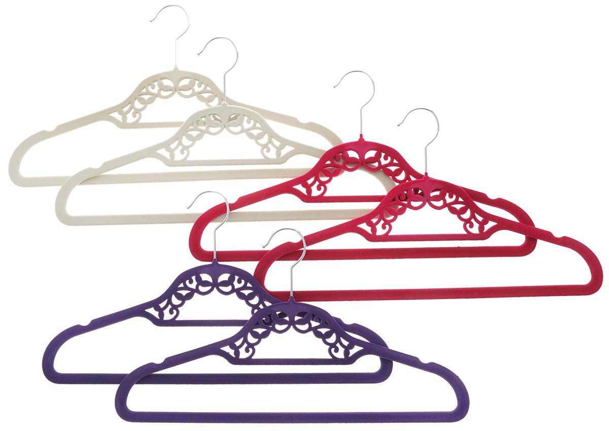 Набор вешалок El Casa, цвет: фиолетовый, малиновый, молочный, 6 шт150028Набор вешалок El Casa состоит из 6 разноцветных вешалок, изготовленных из пластика c велюровым антискользящим покрытием. Изделия имеют легкий и прочный каркас, вращающийся крючок, перекладину и две выемки для юбок или маечек. Вешалка - это незаменимая вещь для того, чтобы ваша одежда всегда оставалась в хорошем состоянии. Набор El Casa станет практичным и полезным в вашем гардеробе. С ним ваша одежда избежит ненужных растяжек и провисаний. Комплектация: 6 шт. Размер вешалки: 41,5 см х 0,5 см х 23 см.