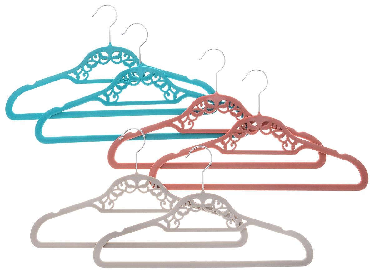 Набор вешалок El Casa, цвет: бирюзовый, темно-розовый, светло-серый, 6 шт150027Набор вешалок El Casa состоит из 6 разноцветных вешалок, изготовленных из пластика c велюровым антискользящим покрытием. Изделия имеют легкий и прочный каркас, вращающийся крючок, перекладину и две выемки для юбок или маечек. Вешалка - это незаменимая вещь для того, чтобы ваша одежда всегда оставалась в хорошем состоянии. Набор El Casa станет практичным и полезным в вашем гардеробе. С ним ваша одежда избежит ненужных растяжек и провисаний. Комплектация: 6 шт. Размер вешалки: 41,5 см х 0,5 см х 23 см.