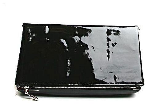 Клатч женский Milana, цвет: черный. 151647-1-110151647-1-110Клатч Milana выполнен из искусственной лакированной кожи. Сумка закрывается застежку-молнию и магнит. Внутри - одно большое вместительное отделение. Также внутри - один втачной карман на застежке-молнии и два небольших накладных кармана для телефона и разных мелочей. Изделие оснащено удобным плечевым ремнем. В этом сезоне этот модный аксессуар поможет вам быть в тренде!