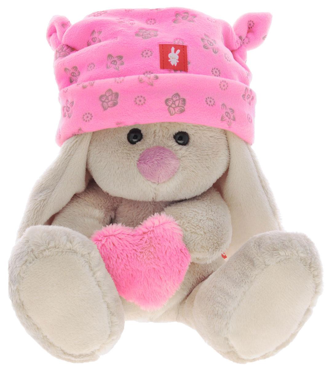 Мягкая игрушка Зайка Ми в шапке и с сердечком цвет розовый 15 смSidXt75Мягкая игрушка Зайка Ми подарит малышу немало прекрасных мгновений. Мягкая игрушка изготовлена на основе сказочных образов двух зайчиков. Зайки Мика и Мия похожи друг на друга, как две пуговки на одной рубашке. Поэтому все зовут их ЗайкаМи. Эти милые зайки необыкновенно творческие натуры и ни минуты не сидят без дела. Выбери своего Зайку, или собери их несколько вместе! У Зайки маленькие черные глазки, длинные мягкие ушки и симпатичный носик. У игрушки необыкновенно нежная, розовая шапочка с отворотом и оригинальными завязками-ушками. Ткань - хлопок с цветочным принтом. Зайчонок крепко держит в лапках розовое плюшевое сердечко. Мягкие игрушки очень полезны для малышей, потому как весьма позитивно влияют на детскую нервную систему, прогоняя всевозможные страхи. Играя, малыш развивает фантазию и воображение, развивает тактильную чувствительность и хватательные рефлексы. Игрушка выполнена из нетоксичных гипоаллергенных материалов и содержит мелкие гранулы,...