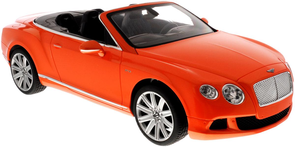 Rastar Радиоуправляемая модель Bentley Continental GT Speed Convertible цвет оранжевый49900_оранжевыйРадиоуправляемая модель Rastar Bentley Continental GT Speed Convertible станет отличным подарком любому мальчику! Все дети хотят иметь в наборе своих игрушек ослепительные, невероятные и крутые автомобили на радиоуправлении. Тем более, если это автомобиль известной марки с проработкой всех деталей, удивляющий приятным качеством и видом. Одной из таких моделей является автомобиль на радиоуправлении Rastar Bentley Continetal GT Speed Convertible. Это точная копия настоящего авто в масштабе 1:12. Авто обладает неповторимым провокационным стилем и спортивным характером. Потрясающая маневренность, динамика и покладистость - отличительные качества этой модели. Возможные движения: вперед, назад, вправо, влево, остановка. Имеются световые эффекты. Пульт управления работает на частоте 40 MHz. Для работы игрушки необходимы 5 батареек типа АА (не входят в комплект). Для работы пульта управления необходима 1 батарейка 9V (6F22) (не входит в комплект).