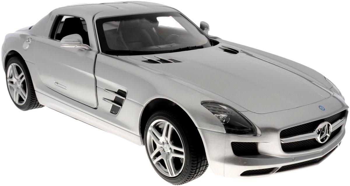 Rastar Радиоуправляемая модель Mercedes-Benz SLS AMG цвет серебристый47600_серебристыйРадиоуправляемая модель Rastar Mercedes-Benz SLS AMG станет отличным подарком любому мальчику! Все дети хотят иметь в наборе своих игрушек ослепительные, невероятные и крутые автомобили на радиоуправлении. Тем более, если это автомобиль известной марки с проработкой всех деталей, удивляющий приятным качеством и видом. Одной из таких моделей является автомобиль на радиоуправлении Rastar Mercedes-Benz SLS AMG. Это точная копия настоящего авто в масштабе 1:14. Авто обладает неповторимым провокационным стилем и спортивным характером. Потрясающая маневренность, динамика и покладистость - отличительные качества этой модели. Возможные движения: вперед, назад, вправо, влево, остановка. Дверцы машины открываются. Имеются световые эффекты. Пульт управления работает на частоте 40 MHz. Для работы игрушки необходимы 5 батареек типа АА (не входят в комплект). Для работы пульта управления необходима 1 батарейка 9V (6F22) (не входит в комплект).