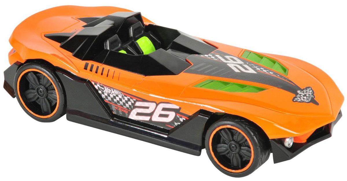 Hot Wheels Машина на радиоуправлении Nitro Charger цвет оранжевый90410TS_ оранжевыйРадиоуправляемая модель Nitro Charger привлечет внимание не только ребенка, но и взрослого и станет отличным подарком любителю всего оригинального и необычного. Машинка является уменьшенной копией спортивного автомобиля с мощнейшими амортизаторами Nitrocharger Sport. Модель изготовлена из ударопрочной пластмассы высокого качества, шины выполнены из мягкой резины. При помощи пульта управления она перемещается вперед, дает задний ход, поворачивает влево и вправо. Мотор машины может работать в режиме турбо, благодаря чему она разгоняется до большой скорости. Авто не только эффектно выглядит, но еще у него подсвечивается двигатель. Машина обладает высокой стабильностью движения, что позволяет полностью контролировать его процесс, управляя уверенно и без суеты. Подсвеченный двигатель, резина на колесах и высокая детализация - все это позволит почувствовать настоящее удовольствие от управления машиной. Ваш ребенок часами будет играть с моделью, придумывая различные...