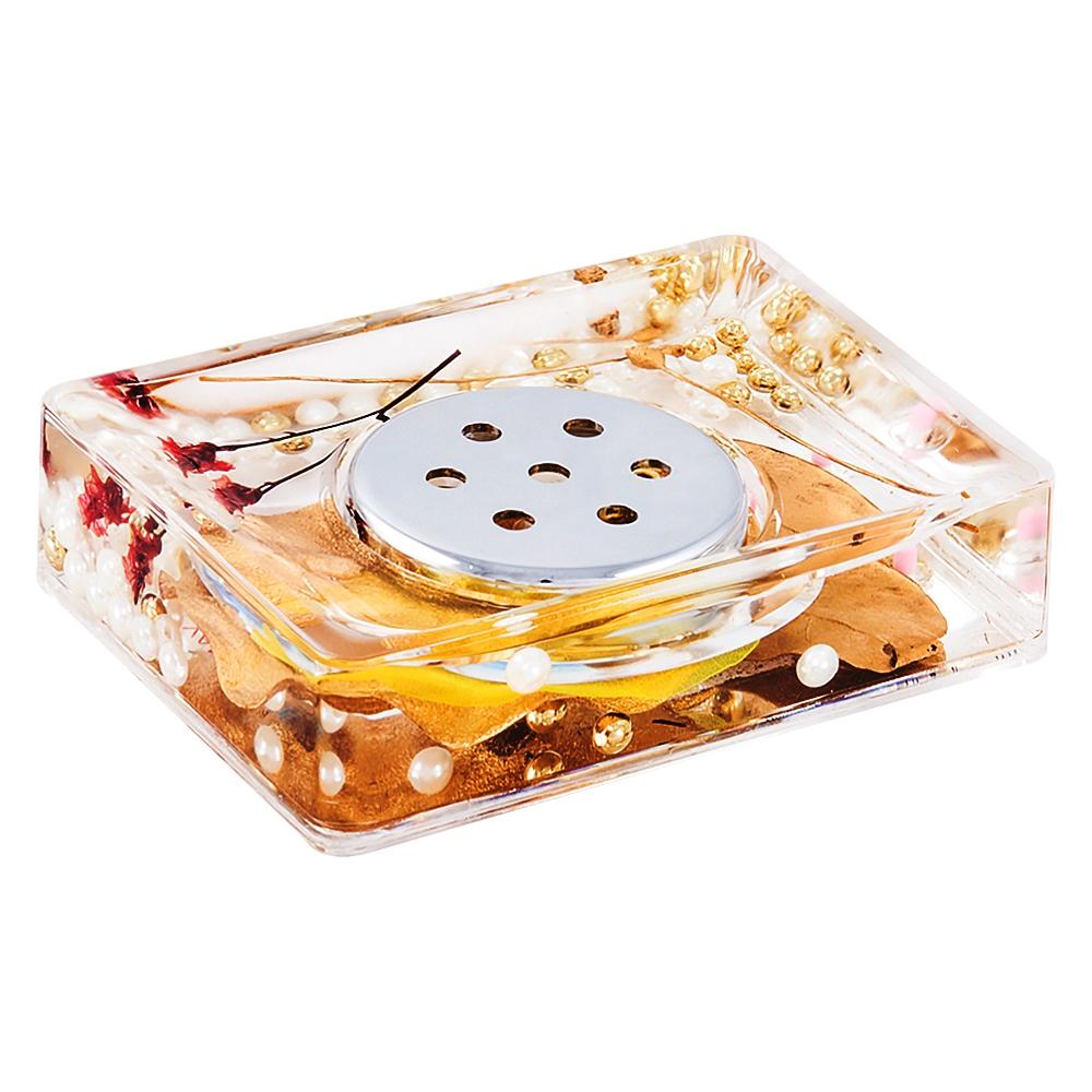 Мыльница Gold Leaf887-88Оригинальная мыльница Gold Leaf, изготовленная из пластика, отлично подойдет для вашей ванной комнаты. Внутри мыльницы прозрачный гелевый наполнитель с золотистыми и белыми бусинами, веточками и листочками. Мыльница создаст особую атмосферу уюта и максимального комфорта в ванной. Характеристики: Материал: пластик, акрил, гелевый наполнитель. Цвет: золотистый, черный, белый. Размер мыльницы: 10,5 см х 7 см х 3,5 см. Производитель: Швеция. Изготовитель: Китай. Размер упаковки: 11,5 см х 8 см х 4,5 см. Артикул: 887-88.